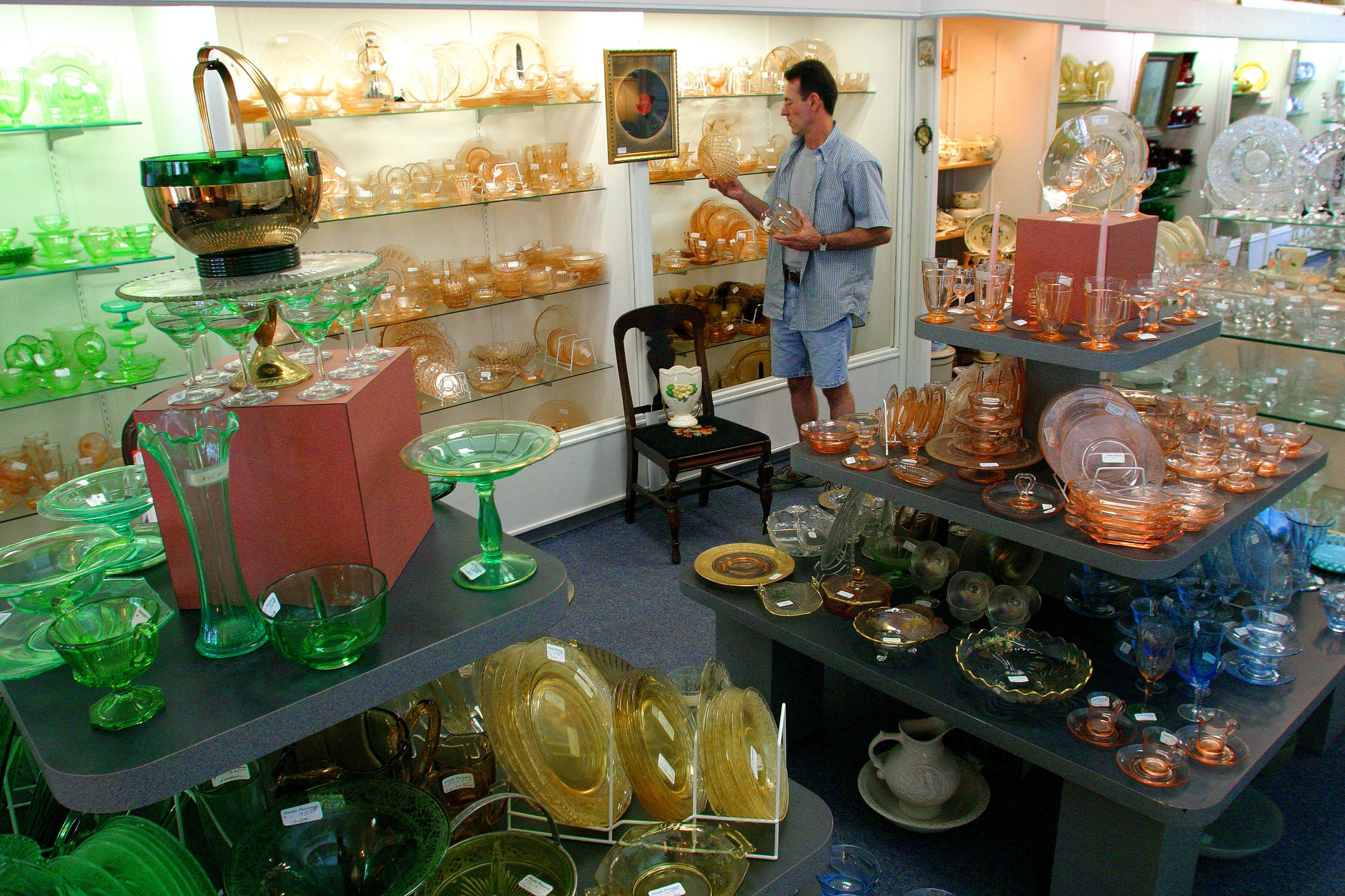 Man looking at glasswares