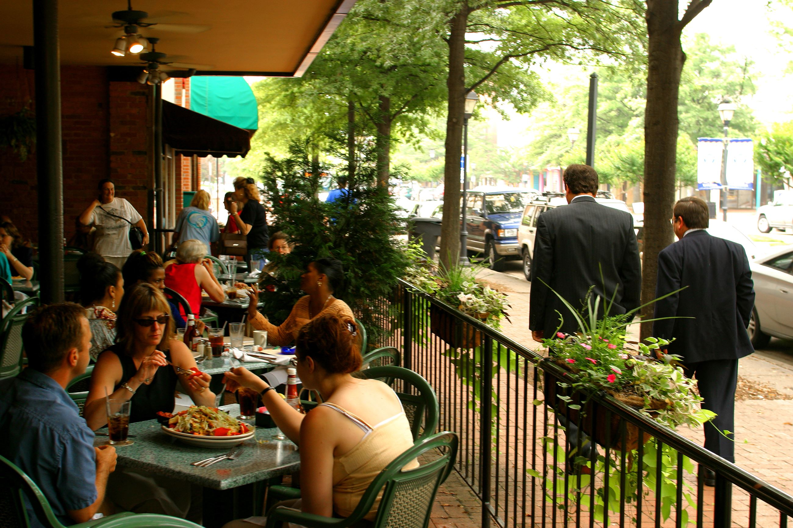 Many diners eating at outside tables