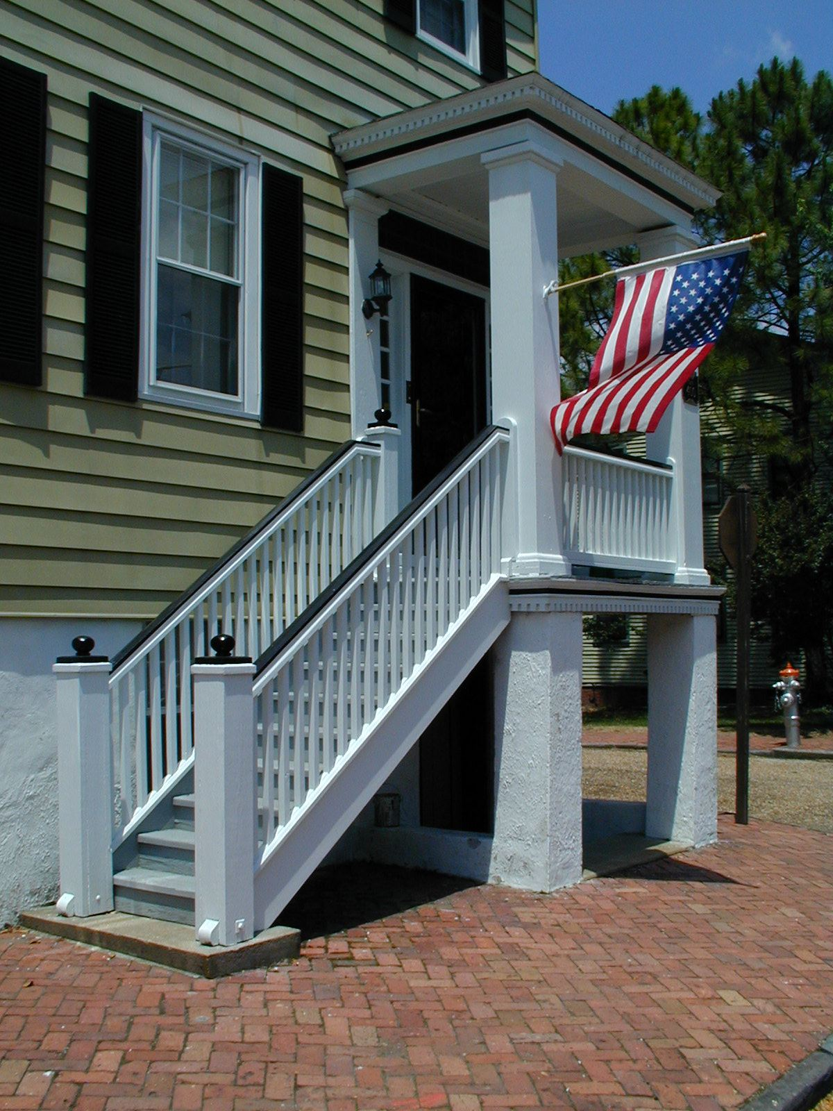 Home entrance with American flag posted